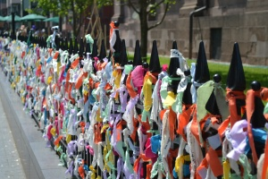 The fence in front of the Boylston Street church with the fabric ribbons tied on.
