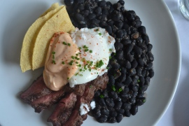 Huevos Rancheros - steak, black beans, cotija cheese, cholula aioli