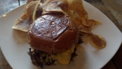 Pressed Shaved Steak Sandwich - horseradish Dijon, sauteed mushrooms, caramelized onions, house chips, sharp American